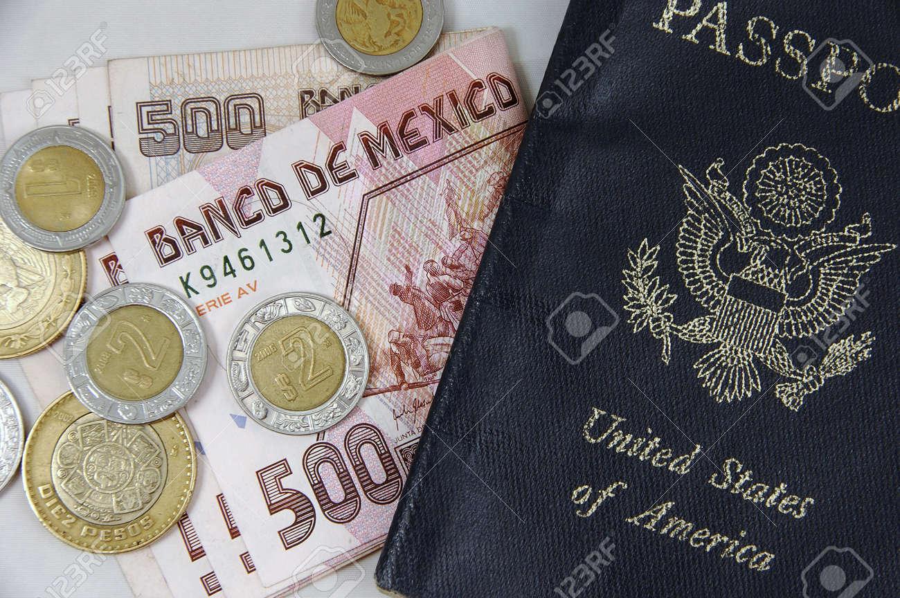 Closeup of Mexican pesos and US passport Stock Photo - 11989518