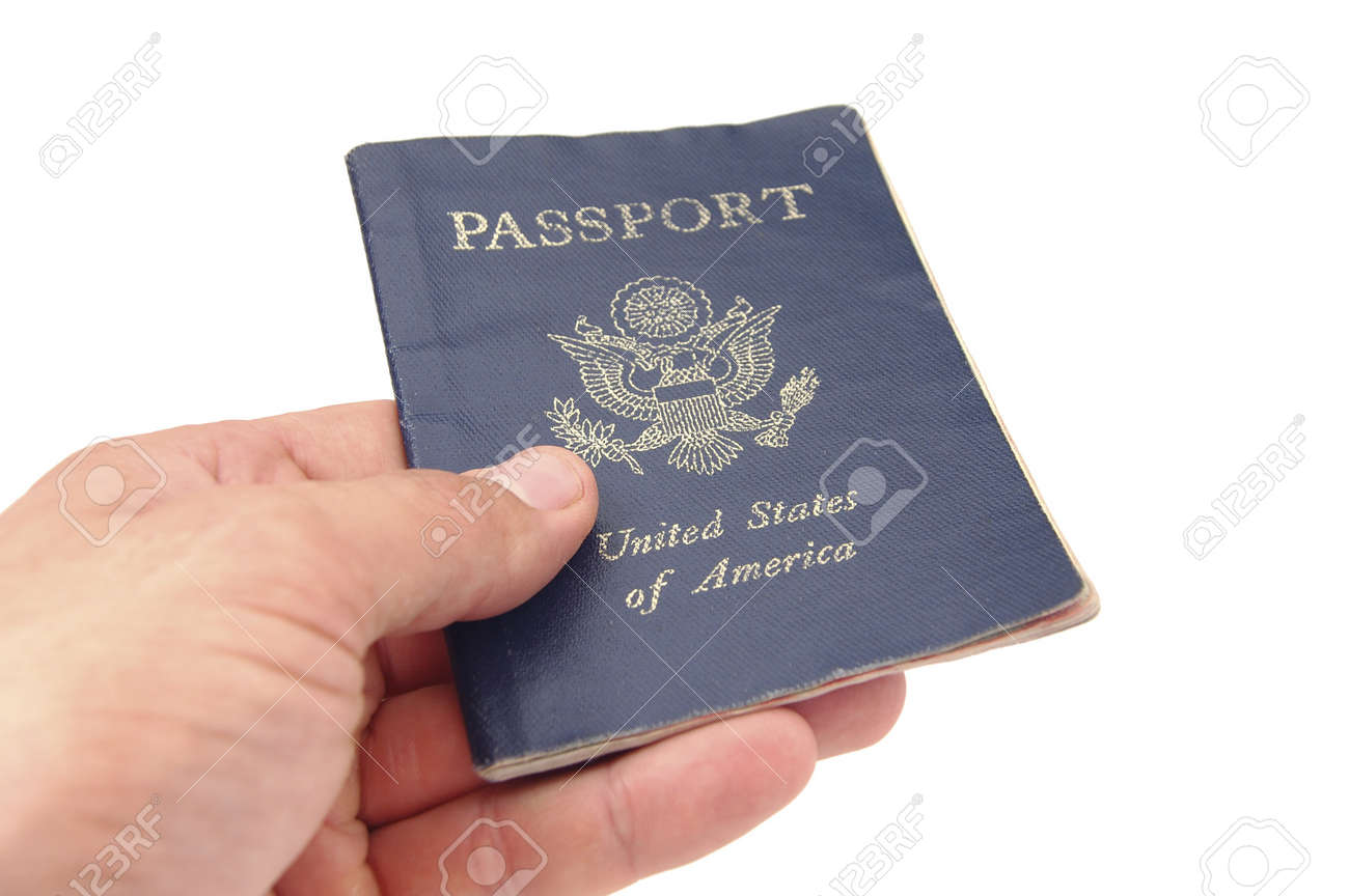 hand holding us passport on white background stock photo picture