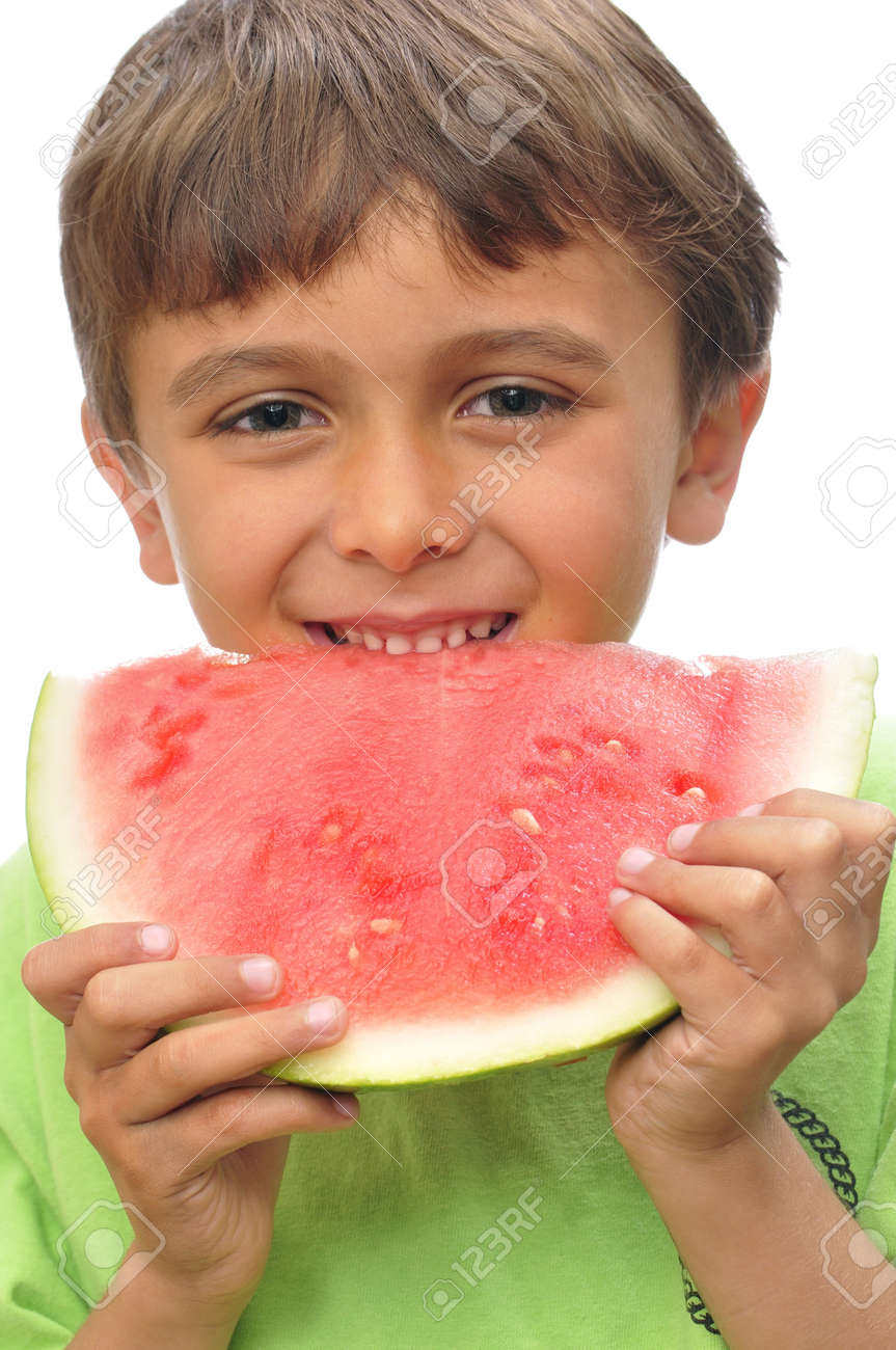 Closeup of cute boy happily eating slice of watermelon Stock Photo - 13956578