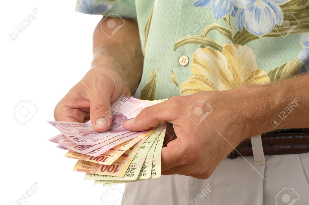 Closeup of unrecognizable male tourist counting handful of pesos,