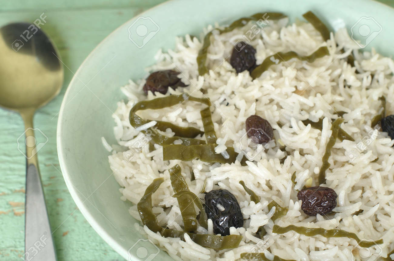Closeup of bowl of white rice with seaweed and raisins Stock Photo - 15691323