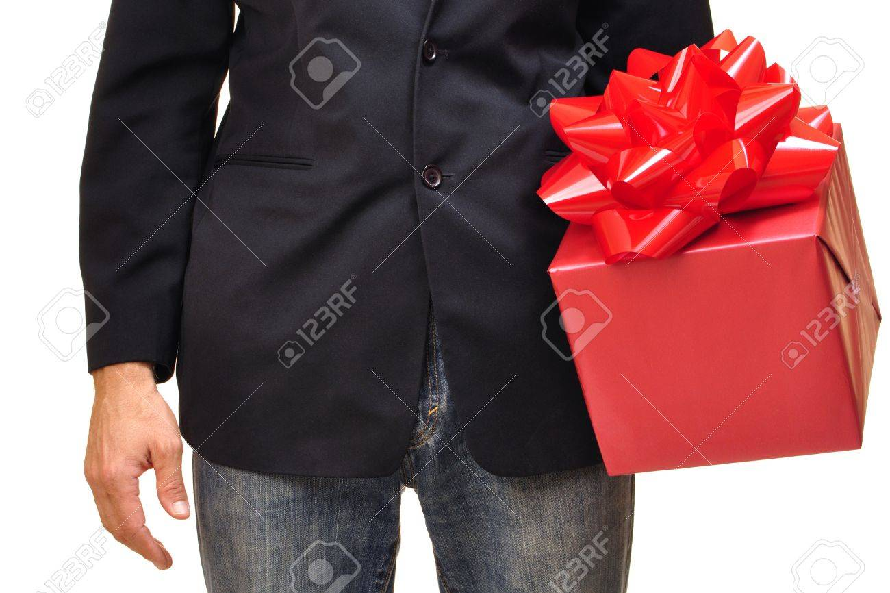 Closeup of unidentifiable man holding red gift with bow on white background Stock Photo - 16727622