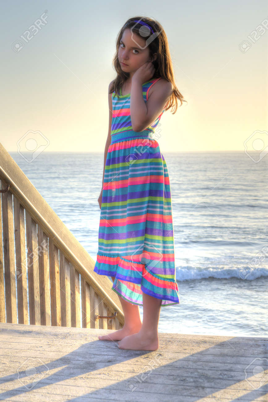 6538f47ef Pretty Little Girl Wearing A Colorful Beach Dress At The Beach Stock ...