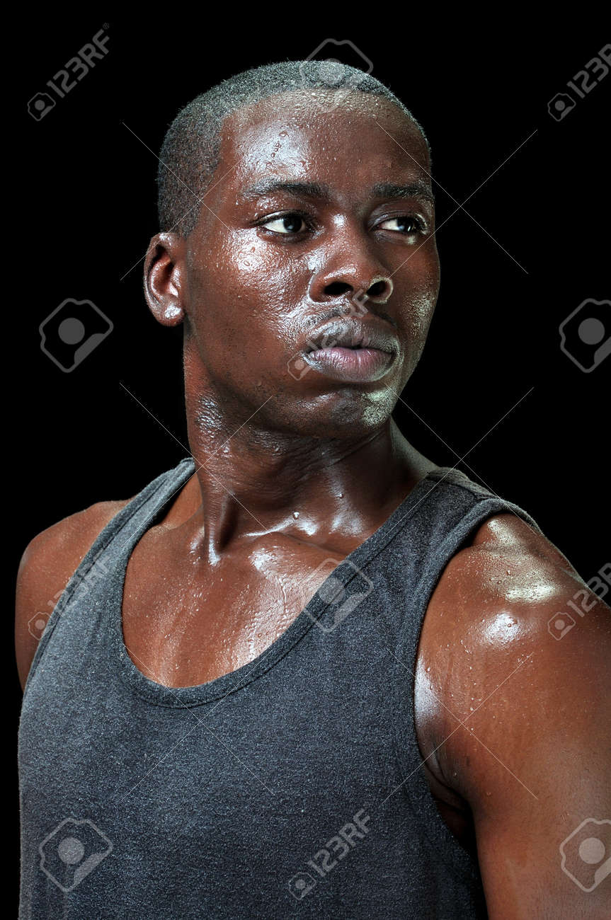 1ae82b35f68a Portrait of attractive young fit black male athlete sweating profusely with  intense expression of determination on