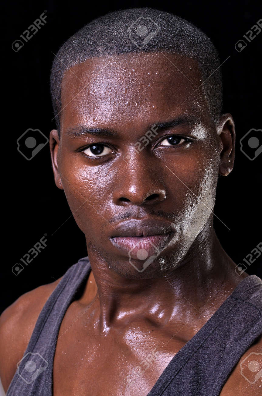 ea9d757b54e6 Portrait of sweaty handsome young athletic man with bold expression of  confidence on black background Stock