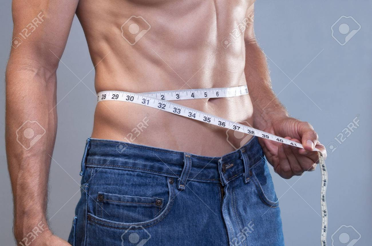 Closeup Of Shirtless Caucasian Man In Blue Jeans Measuring His Stock Photo Picture And Royalty Free Image Image 34356124