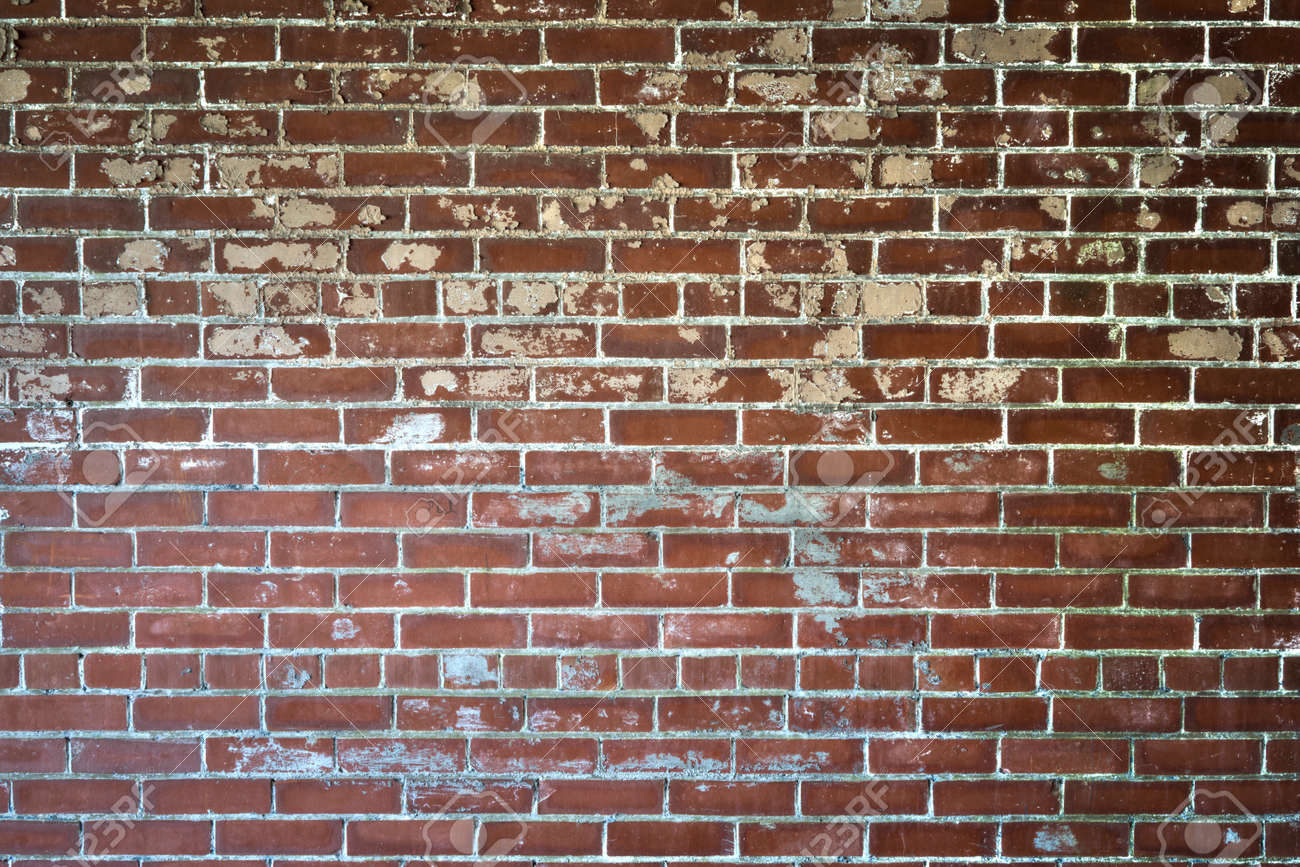 Background Of Red Brick Wall With Textured Peeling Paint Dark Vignette Stock Photo