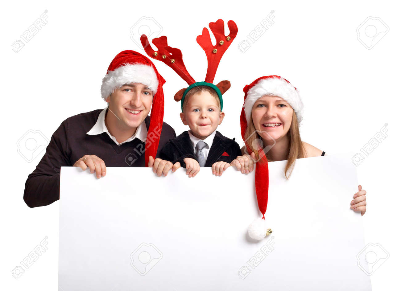 Christmas family with banner. Happy family of three in Christmas hats holds white banner Stock Photo - 2175754