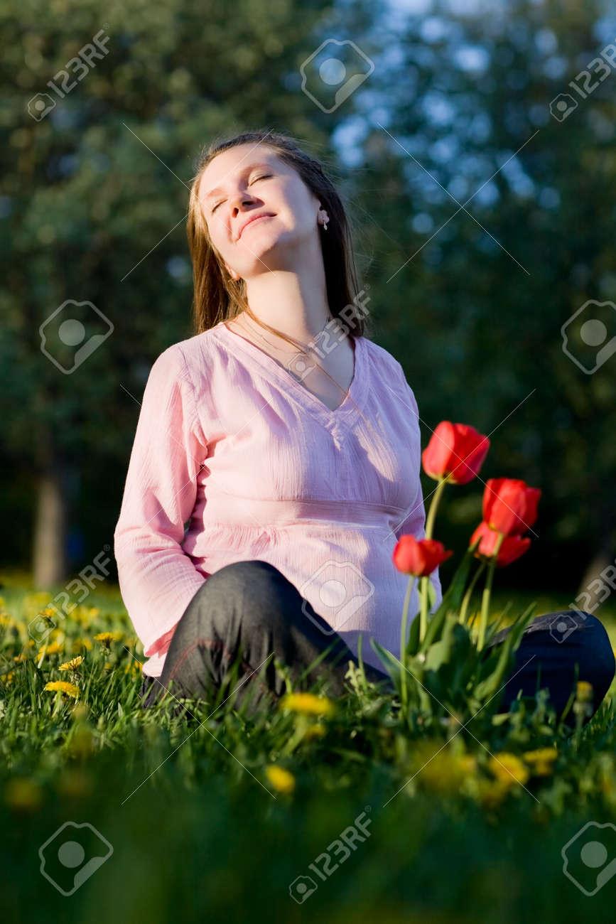 Beautiful pregnant woman enjoying summer sunny day Stock Photo - 3055252