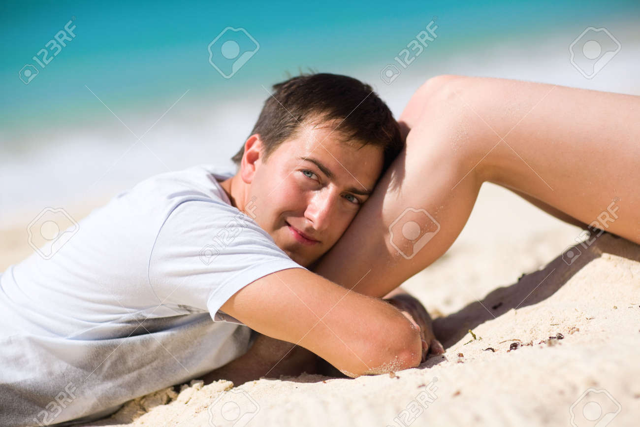 Happy handsome man on tropical beach at sunny day Stock Photo - 4098487