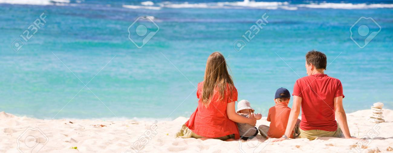 Family vacation. Young family of four in tropical paradise Stock Photo - 4224230