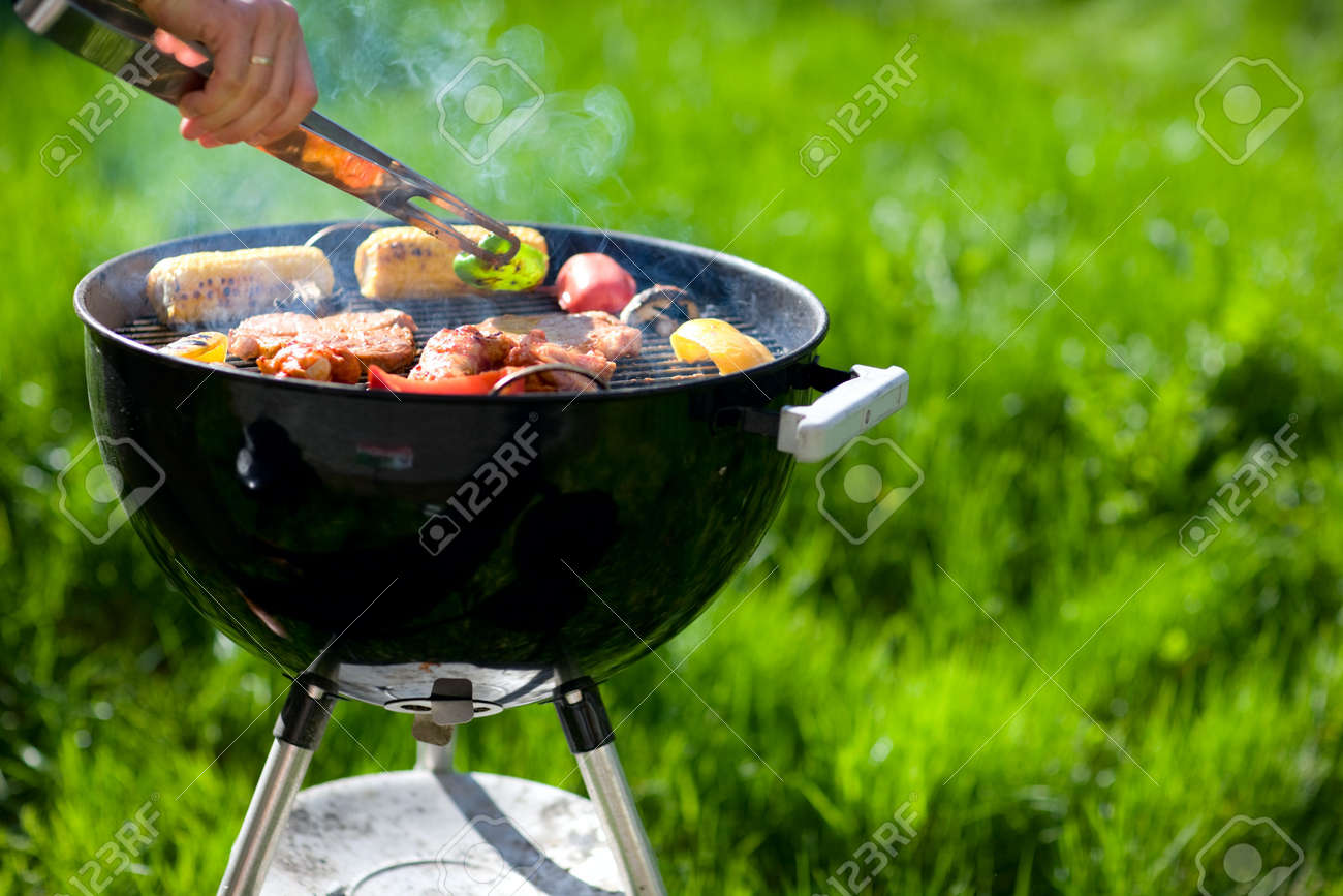 Grilling at summer weekend. Fresh meat and vegetables preparing on grill. Stock Photo - 4318747
