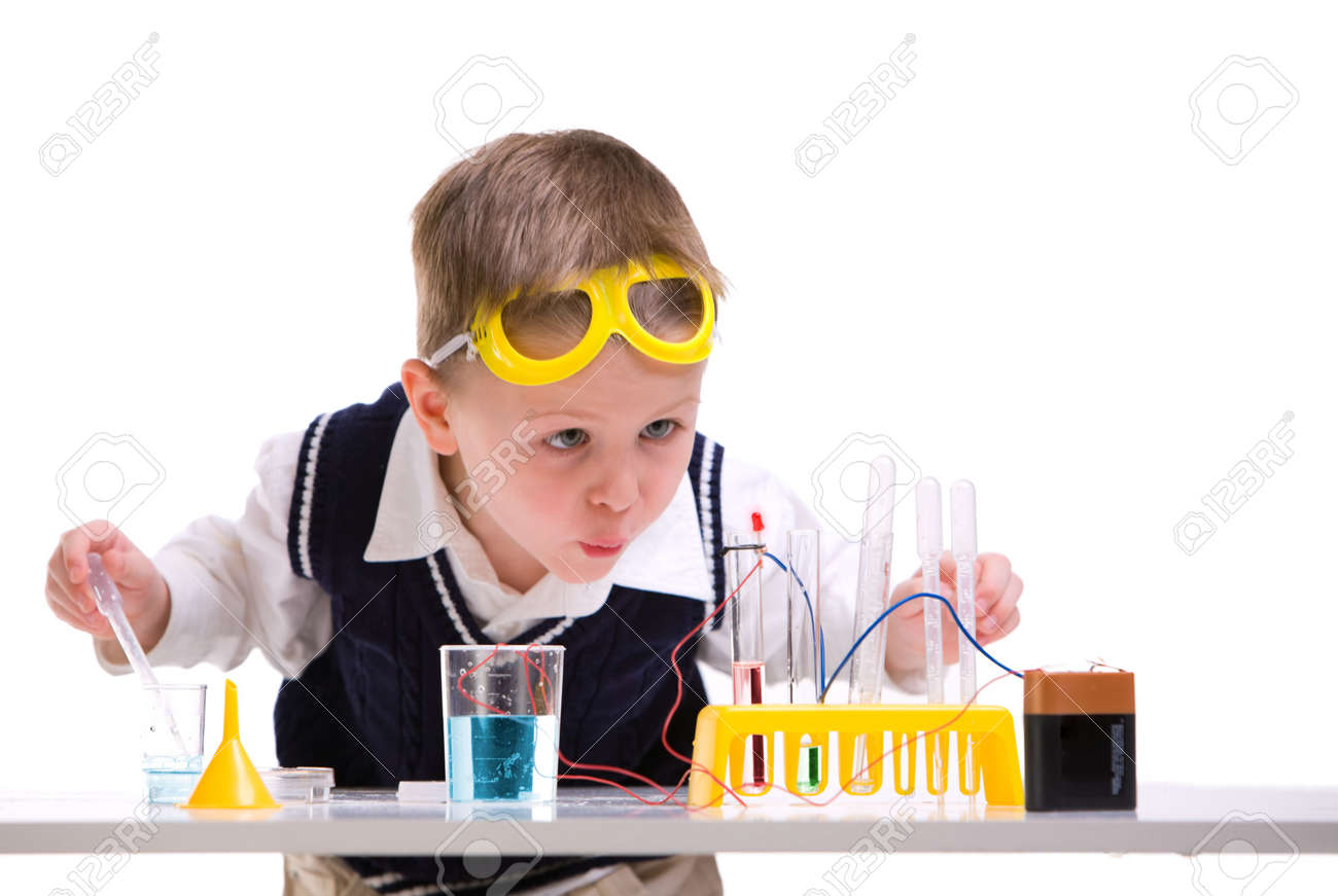 Crazy scientist. Young boy performing experiments with battery and small lamp. - 4379512