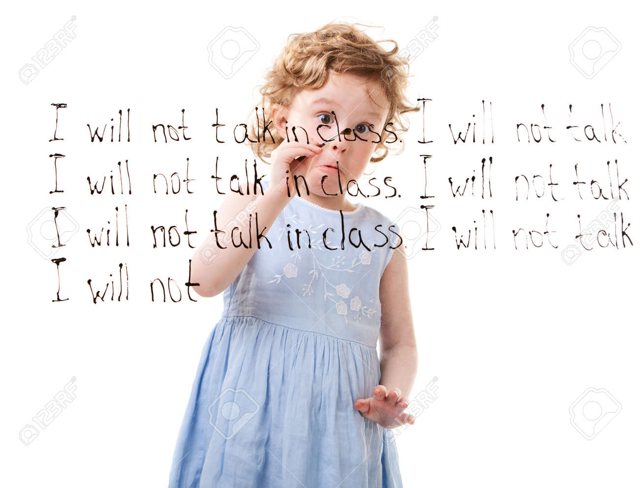 primary school girl writing i will not talk in class sentence primary school girl writing i will not talk in class sentence stock photo 4774064