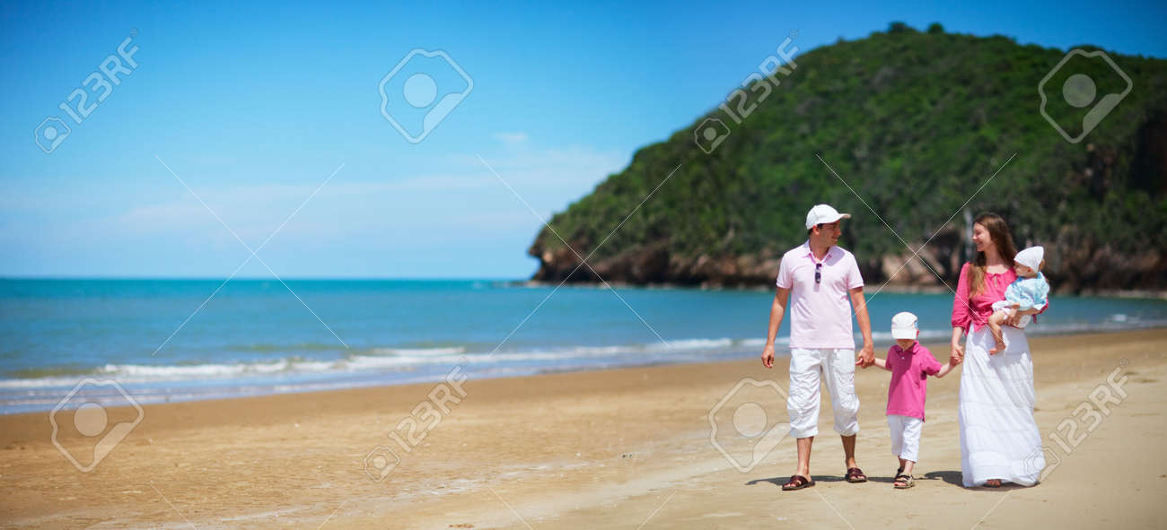 Young happy family with two kids on beach vacation Stock Photo - 5334170