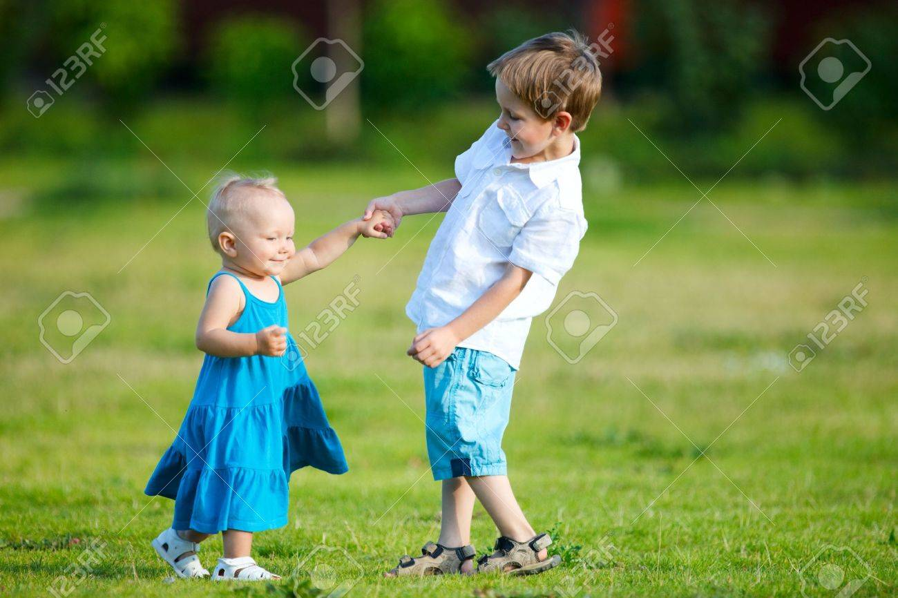 Brother and sister outdoors at sunny day Stock Photo - 5362320