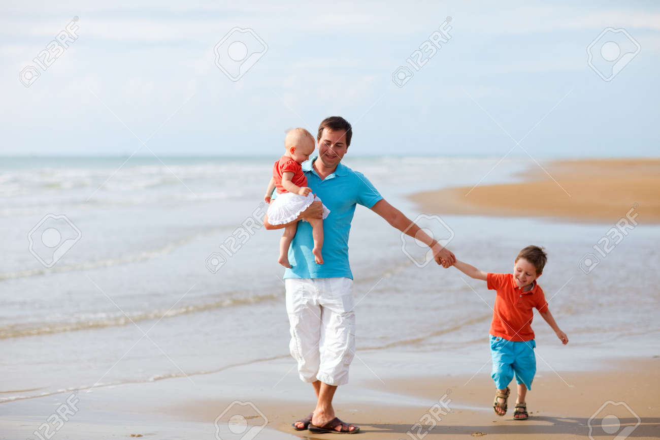 Young father with two kids at the beach Stock Photo - 5440621