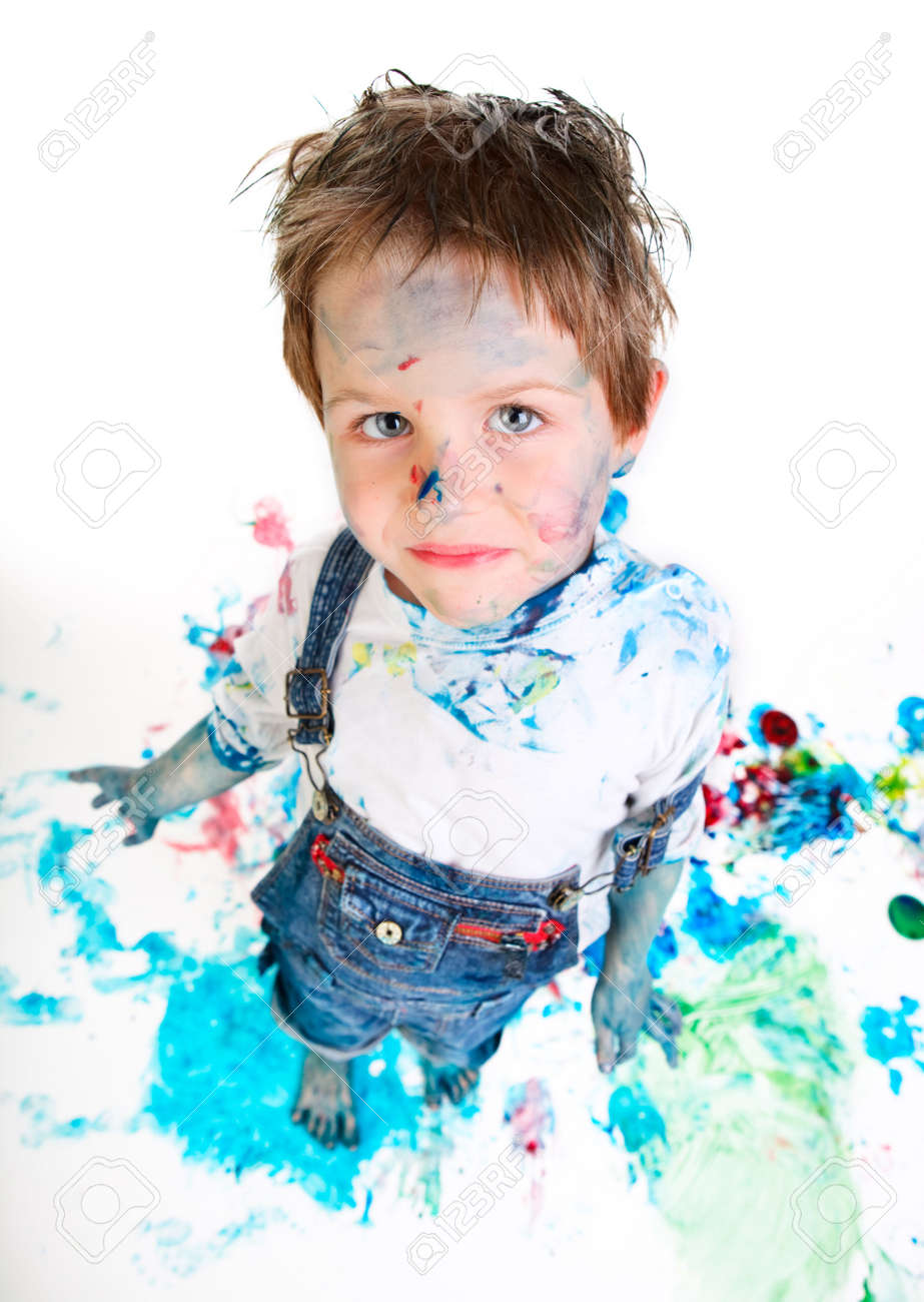 Funny photo of cute 5 years old boy painting on white background Stock Photo - 5774480