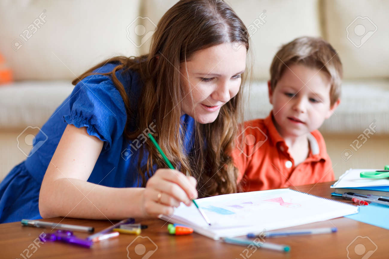Young mother and her two kids drawing together. Can be used also in kindergarten/daycare context Stock Photo - 6276173