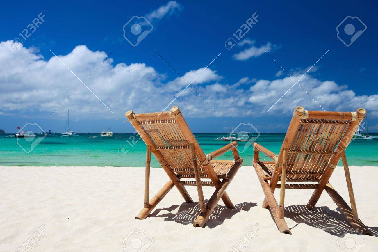 two beach chairs on perfect tropical white sand beach in boracay