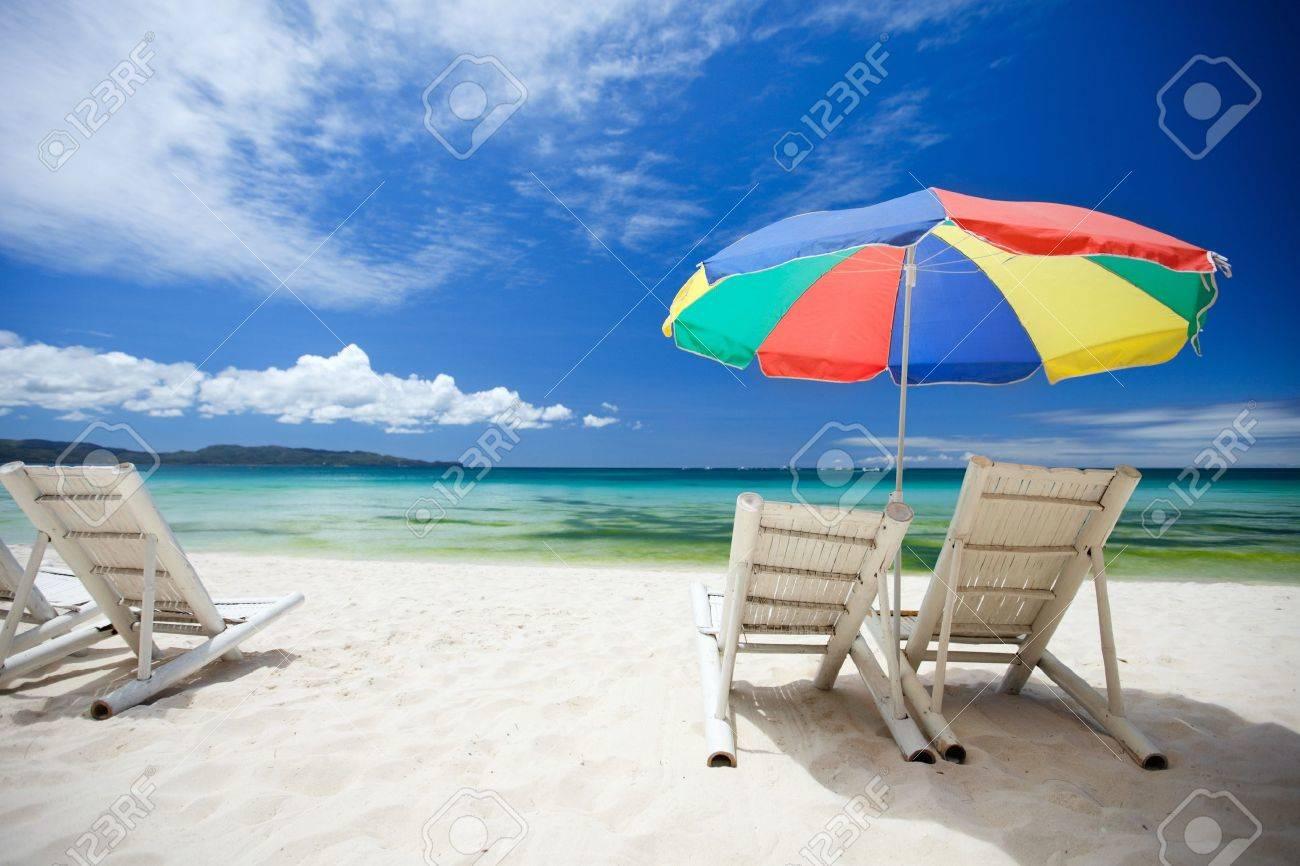 Beach umbrella and chair - Beach Chairs On Perfect Tropical White Sand Beach Stock Photo 6982098