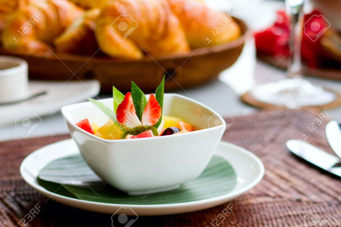Delicious breakfast with fresh fruits, fresh bread selection and coffee Stock Photo - 7406950