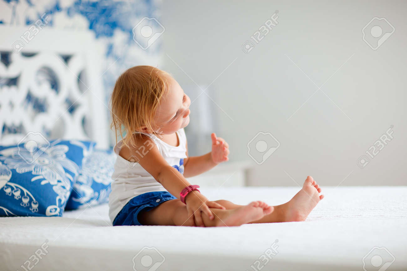 Nicely Decorated Bedrooms Portrait Of Playful Toddler Girl Sitting On Bed In Nicely