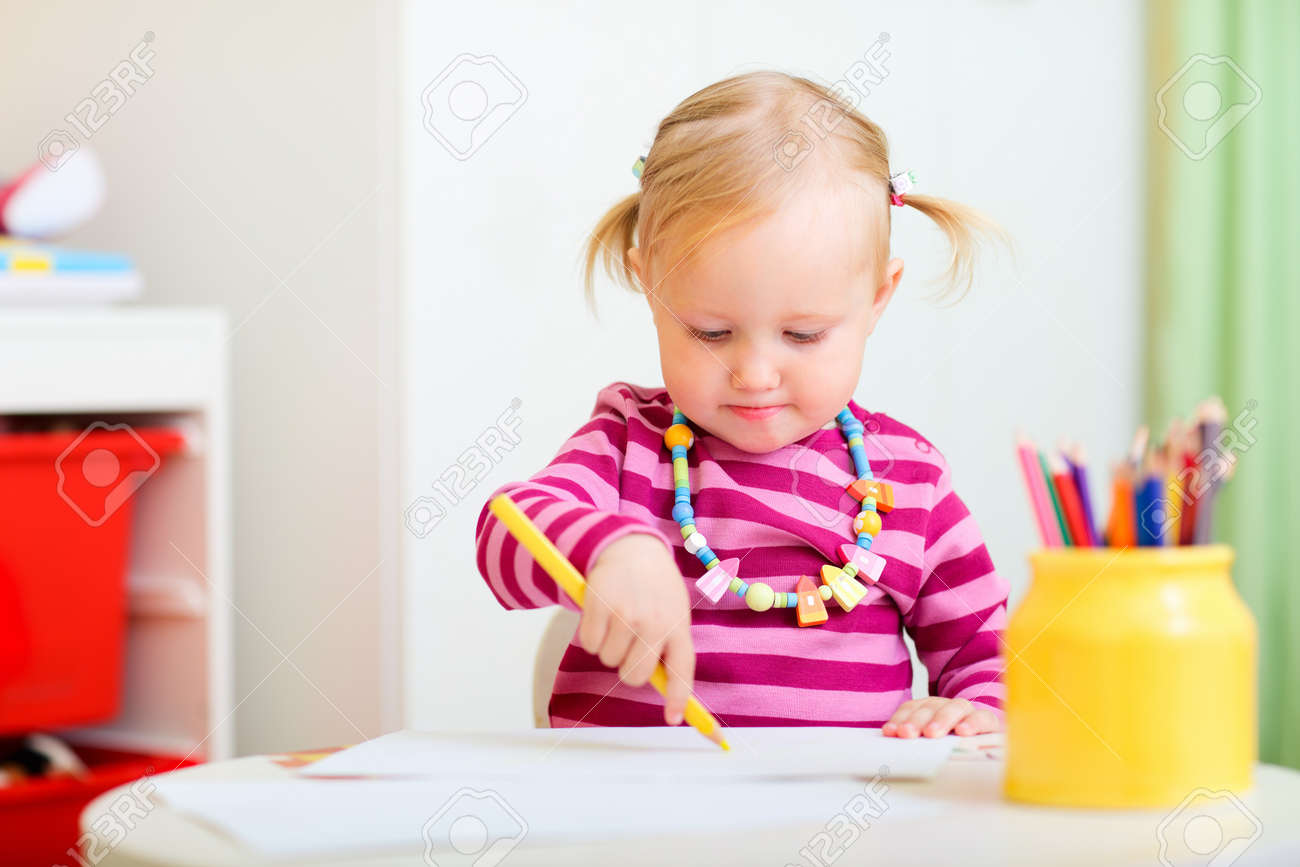 Cute Toddler Girl In Her Room Drawing With Coloring Pencils Stock ...