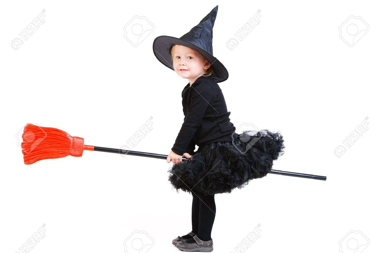 Adorable little witch flying on broomstick isolated on white Stock Photo - 7941720