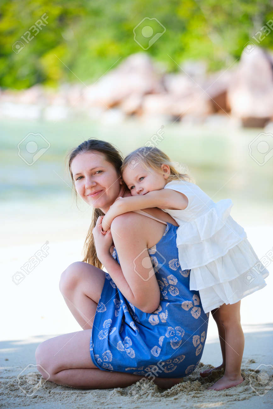 Happy mother and her adorable little daughter on beach Stock Photo - 8610871