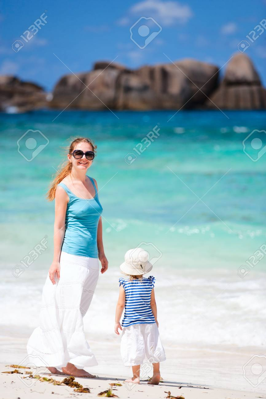 Mother and her toddler daughter enjoying time at beach Stock Photo - 8848575