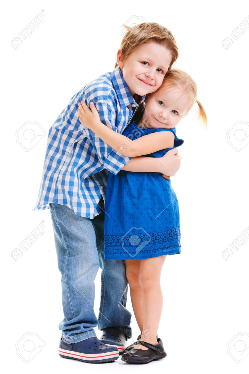 Loving brother and little sister hugging isolated over white - 8848576
