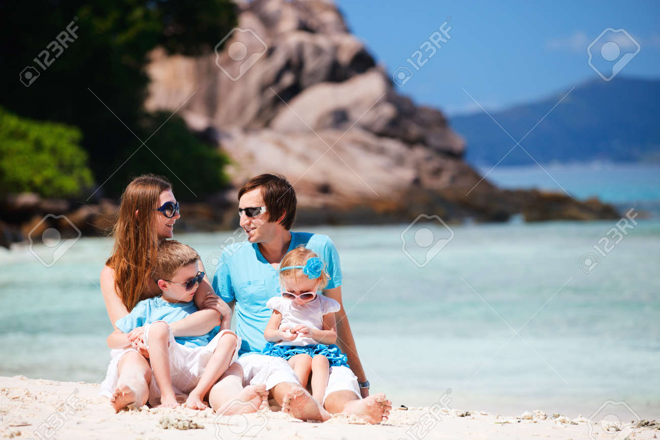 Portrait of happy young family with two kids on tropical vacation Stock Photo - 8848834