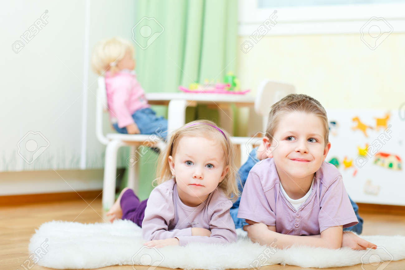 Cute boy and his adorable little sister at home Stock Photo - 9166031