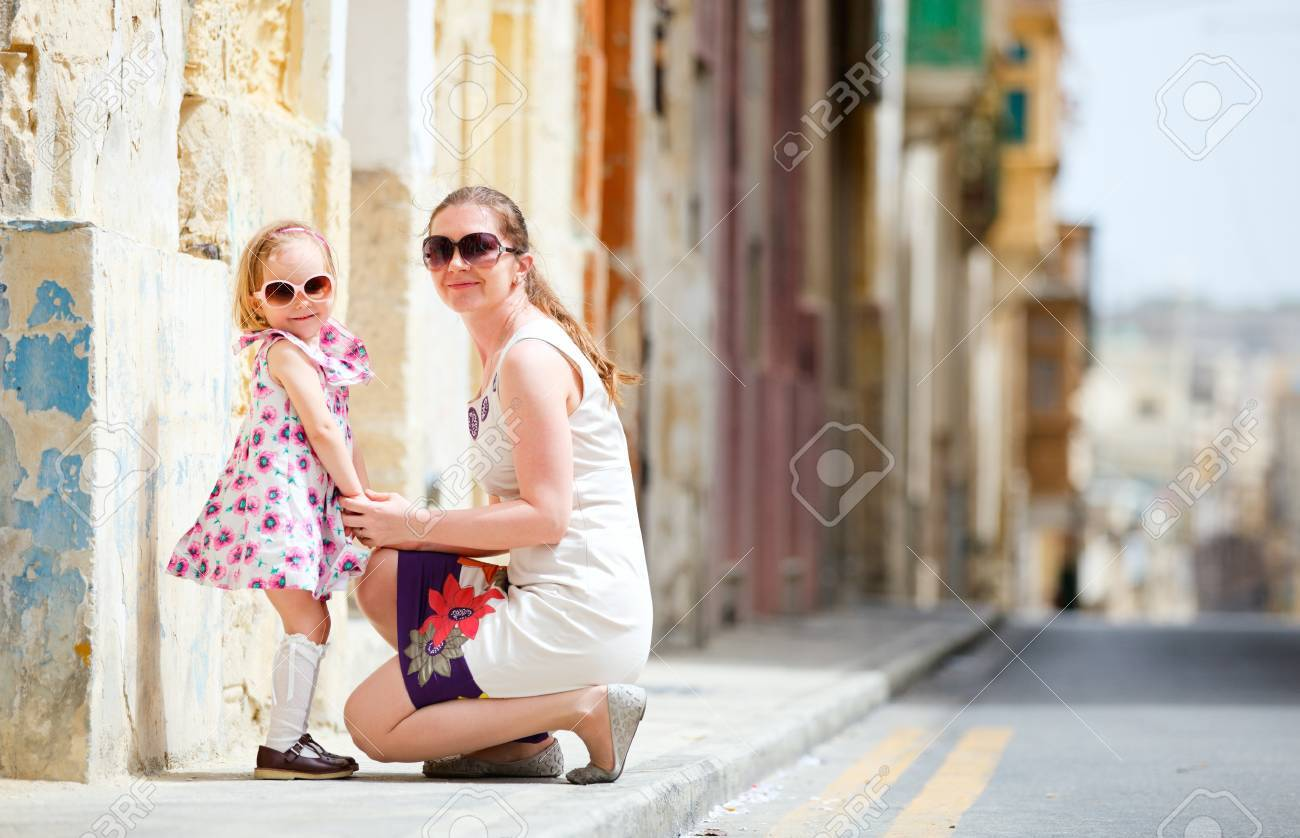 Mother and her little daughter outdoors in European city Stock Photo - 9477678