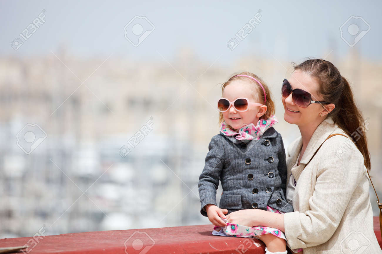 Mother and her little daughter outdoors in city Stock Photo - 9591191