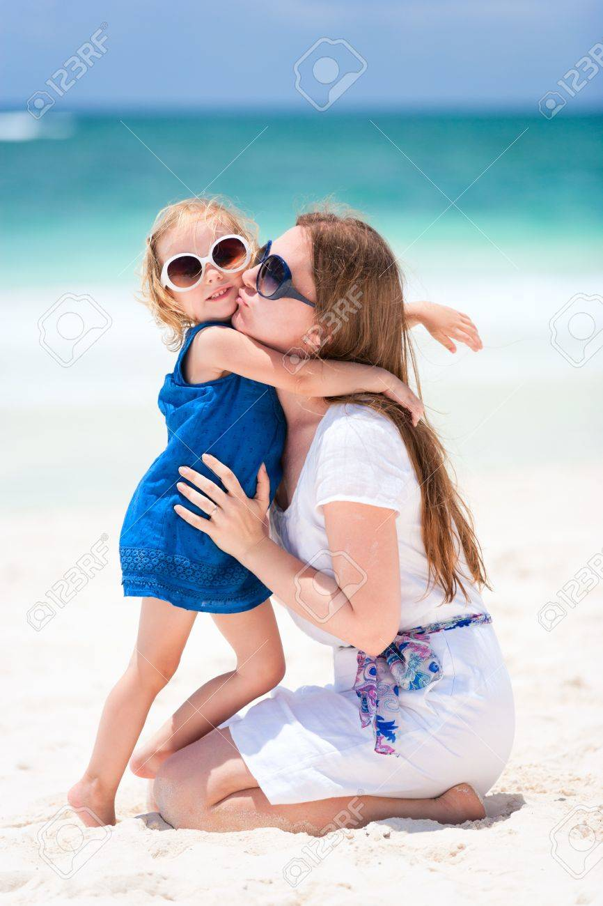 Young mother kissing her little daughter Stock Photo - 9773523