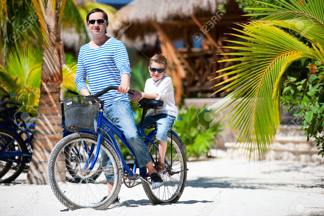 Father And Son Riding A Bike Together Stock Photo, Picture And ...