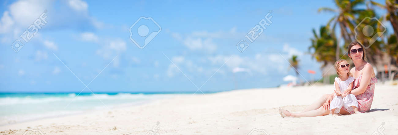Mother and her little daughter enjoying Caribbean beach vacation Stock Photo - 10274582