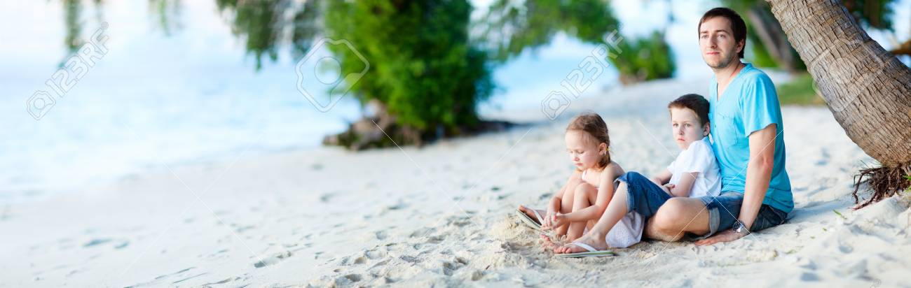 Father and his two kids enjoying time at beach Stock Photo - 13147019