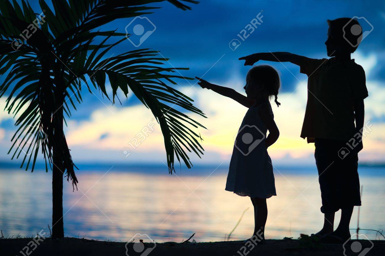 Silhouettes of two little kids at sunset Stock Photo - 13192312