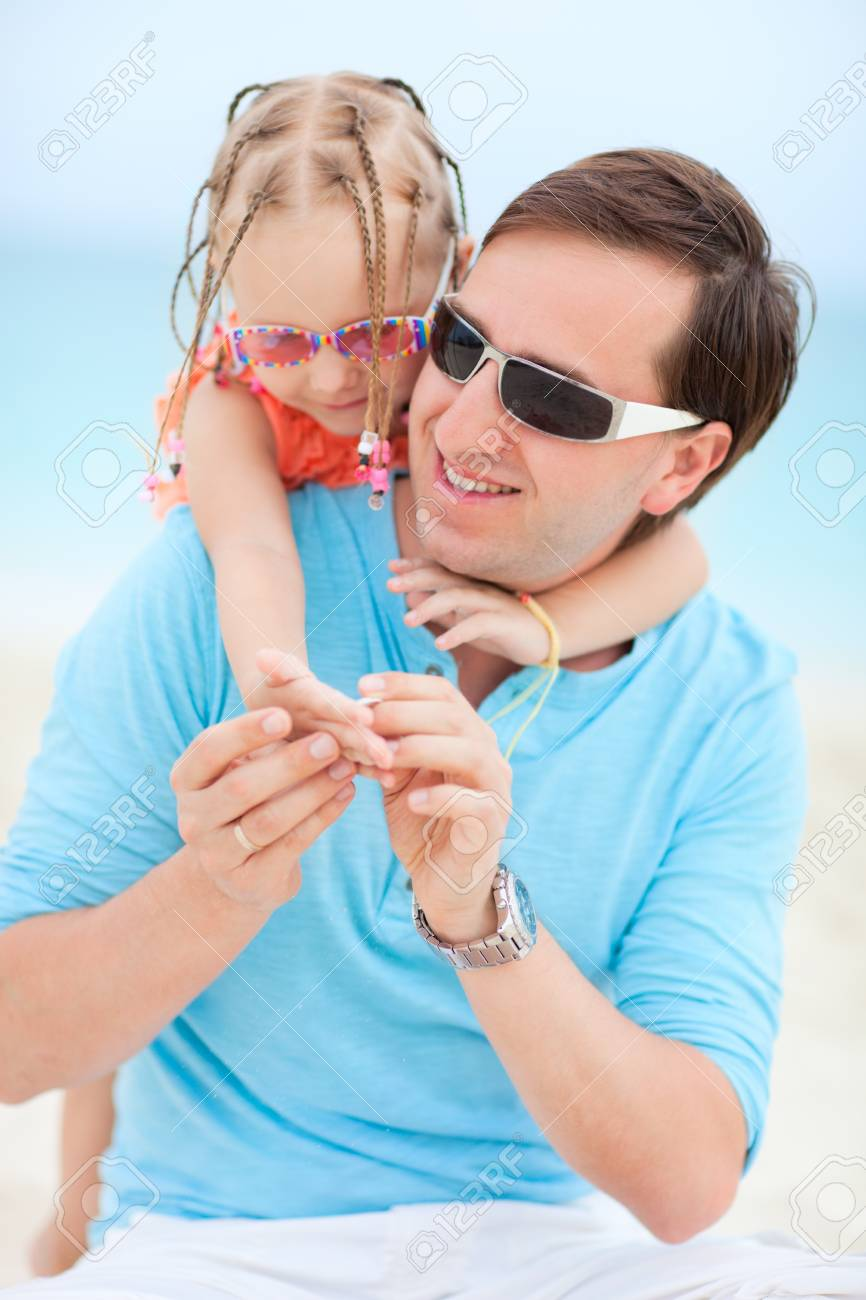Happy father and his sweet little daughter at beach Stock Photo - 13653375