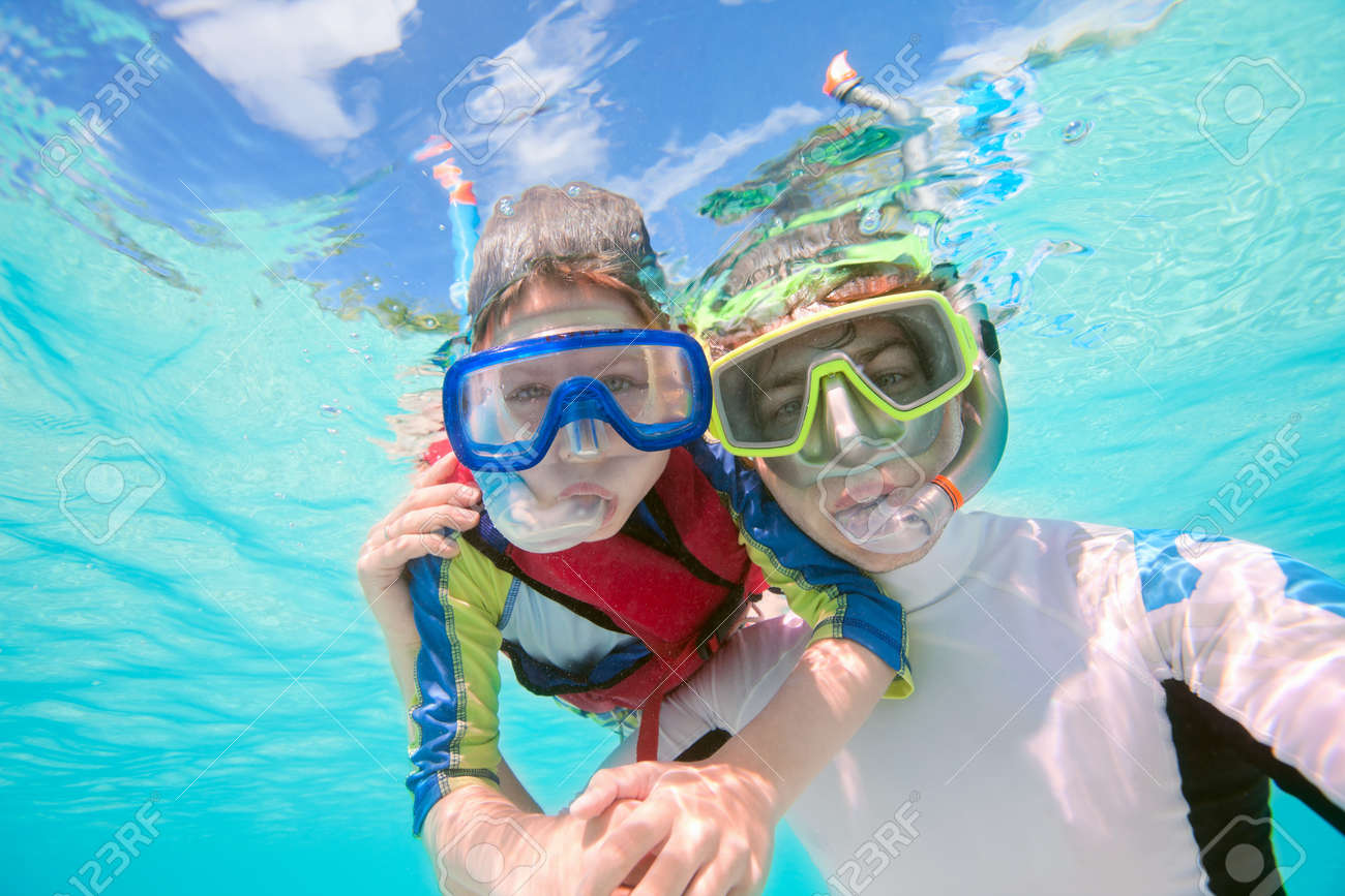 Underwater portrait of father and son snorkeling together Stock Photo - 15810756