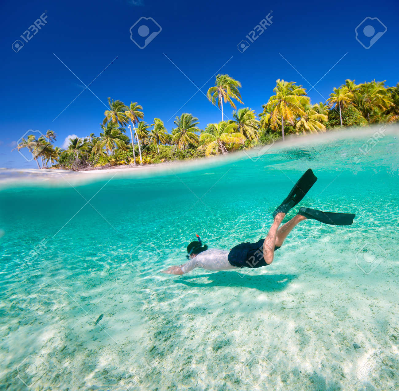 Man swimming underwater in a tropical lagoon Stock Photo - 16250771