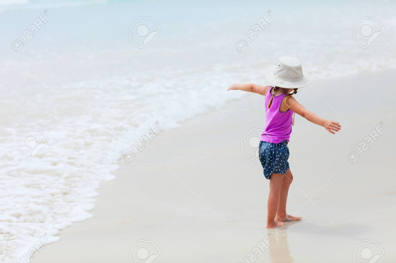 Cute playful little girl at tropical beach Stock Photo - 17603584