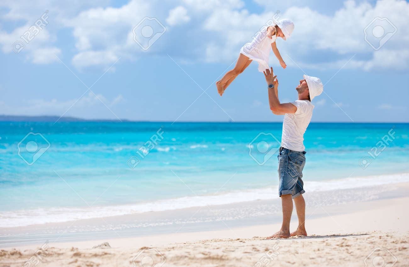 Father and his adorable little daughter at tropical beach having fun Stock Photo - 18499512