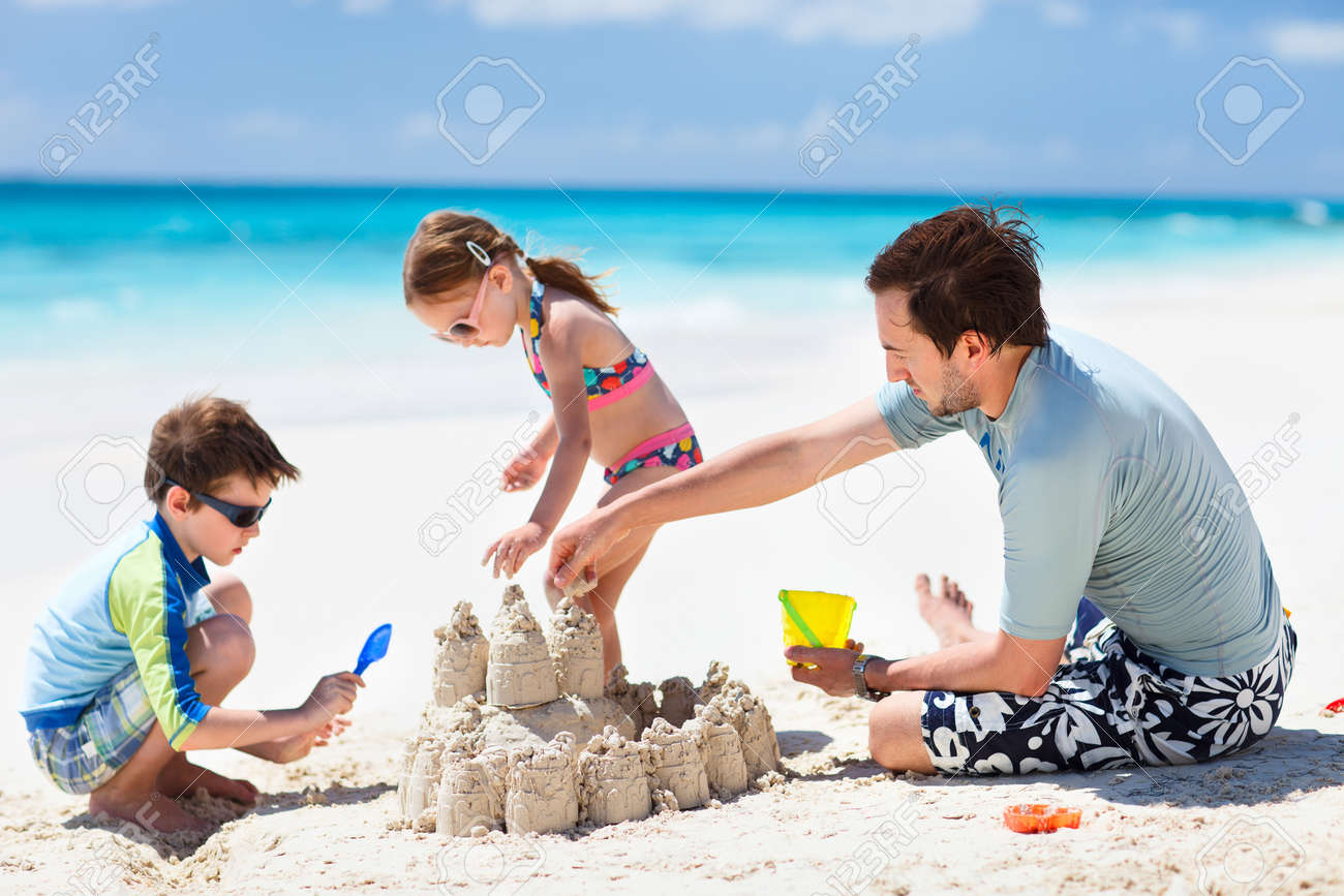 Father and kids making sand castle at tropical beach Stock Photo - 19204055