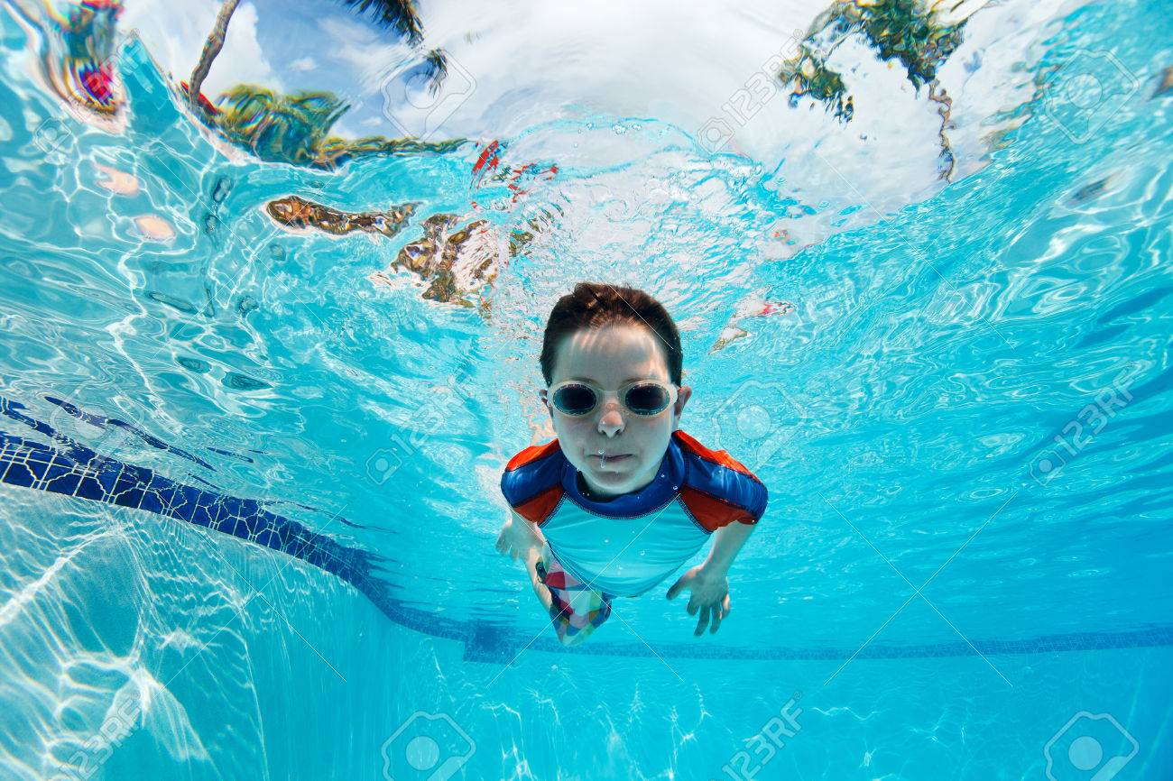 Portrait of a cute little boy swimming underwater Stock Photo - 26335651 3ee2bf749660