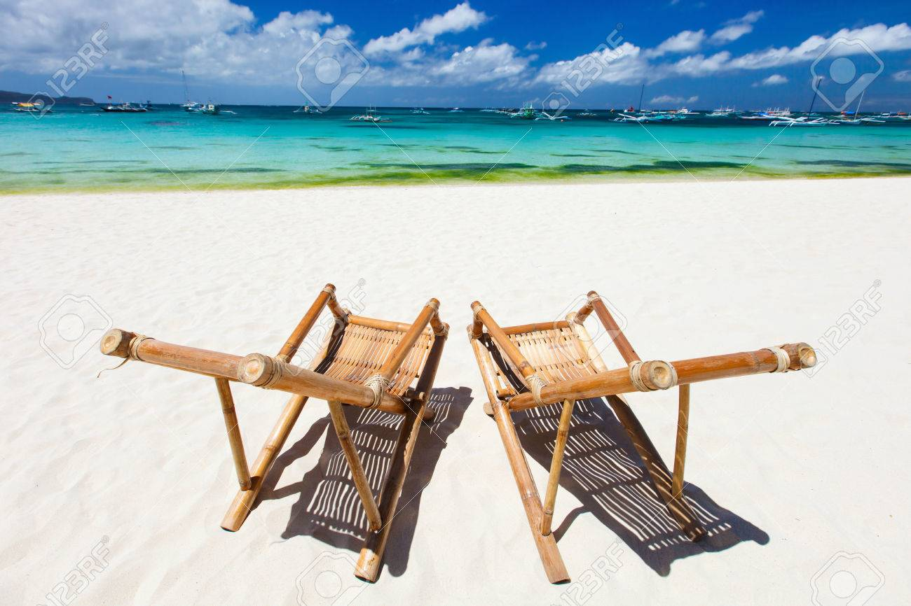 Stock Photo   Two Bamboo Chairs On A Beautiful Tropical Beach With White  Sand And Clear Turquoise Ocean At Exotic Island In Philippines