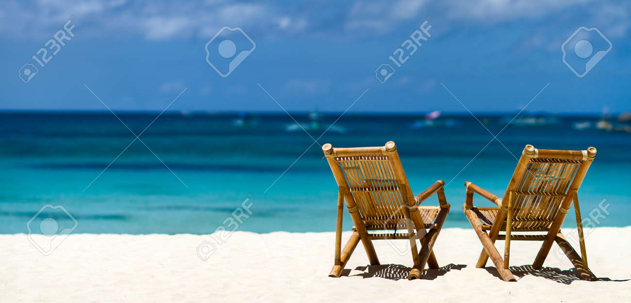 Beach with chairs - Panorama Of Two Bamboo Chairs On A Beautiful Tropical Beach With White Sand And Clear Turquoise